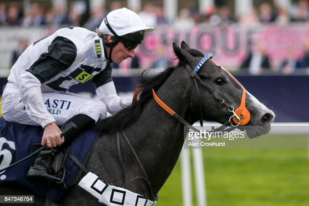 Adam Kirby riding Tip Two Win win The Weatherbys Bank Foreign ExchangeFlying Scotsman Stakes at Doncaster racecourse on September 15 2017 in...
