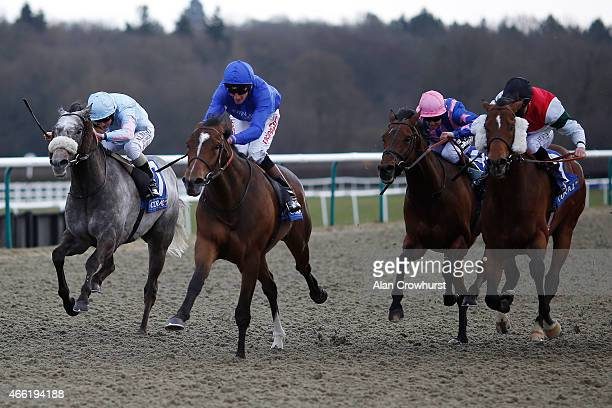 Adam Kirby riding Tryster win The coralcouk Winter Derby at Lingfield racecourse on March 14 2015 in Lingfield England