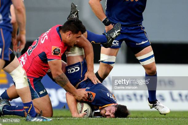 Adam Knight of Otago is tackled by Levi Aumua of Tasman during the round five Mitre 10 Cup match between Otago and Tasman Forsyth Barr Stadium on...
