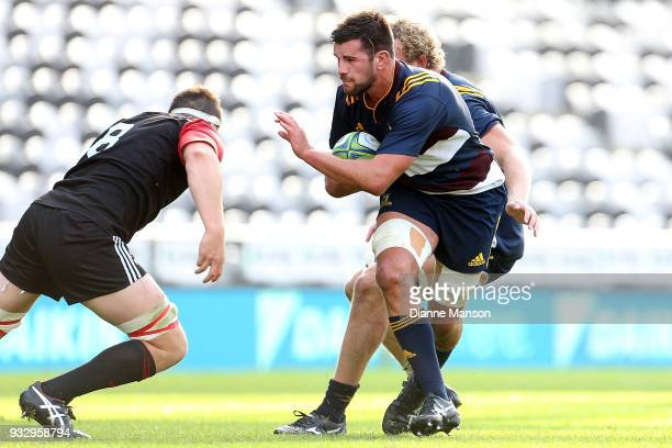 Adam Knight of the Highlanders Bravehearts fends off Tom Sanders of the Crusaders Knights is tackled during the match between Crusaders Knights and...