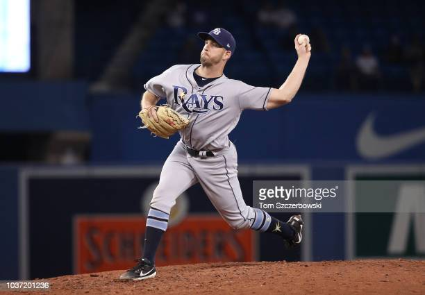 Adam Kolarek of the Tampa Bay Rays delivers a pitch in the ninth inning during MLB game action against the Toronto Blue Jays at Rogers Centre on...