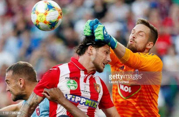 Adam Kovacsik of MOL Vidi FC fists the ball next to Bence Batik of Budapest Honved and Roland Juhasz of MOL Vidi FC during the Hungarian Cup Final...