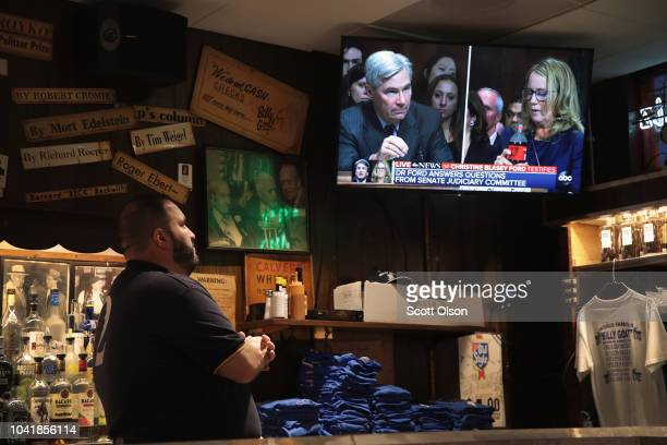 Adam Kruppa bartender at the Billy Goat Tavern watches on television as professor Christine Blasey Ford testifies to the Senate Judiciary Committee...