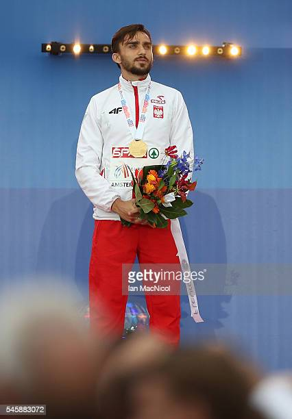 Adam Kszczot of Poland celebrates on the podium after receiving his medal for winning gold in the final of the mens 800m on day five of The 23rd...