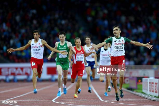 Adam Kszczot of Poland celebrates winning gold ahead of Artur Kuciapski of Poland and Mark English of Ireland in the Men's 800 metres final during...