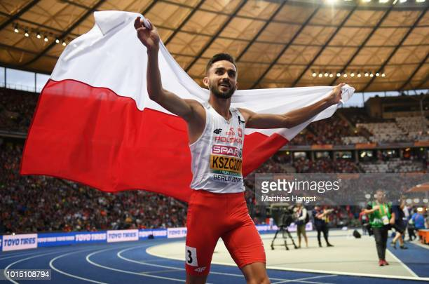 Adam Kszczot of Poland celebrates winning Gold in the Men's 800m during day five of the 24th European Athletics Championships at Olympiastadion on...
