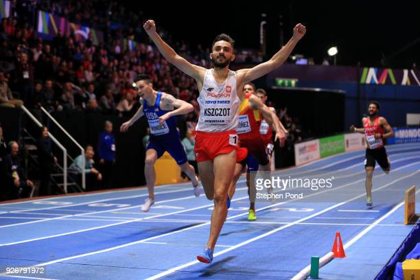 Adam Kszczot of Poland celebrates winning the 800 Metres Mens Final during the IAAF World Indoor Championships on Day Three at Arena Birmingham on...