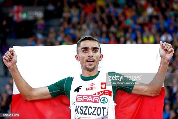 Adam Kszczot of Poland celebrates with the Polish national flag after winning gold in the Men's 800 metres final during day four of the 22nd European...