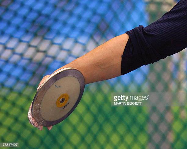 US Adam Kuehl holds the disc as he participates in the Men's Discus Throw during the XV Pan American Games 2007 in Rio de Janeiro Brazil 28 July 2007...