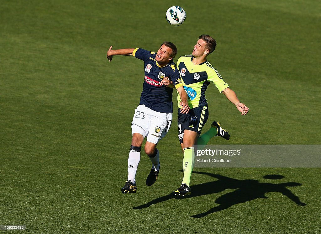 Adam Kwasnik of the Mariners is challenged by Nicholas Ansell of the Victory during the round 16 A-League match between the Melbourne Victory and the Central Coast Mariners at Aurora Stadium on January 12, 2013 in Launceston, Australia.