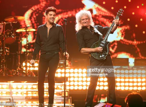 Adam Labert and Brian May of Queen perform onstage during the iHeartRadio Music Festival at the MGM Grand Garden Arena on September 20 2013 in Las...