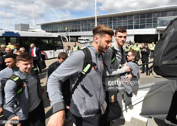 Adam Lallana and Andrew Robertson of Liverpool boarding the plane at Liverpool John Lennon Airport on May 1 2018 in Liverpool England