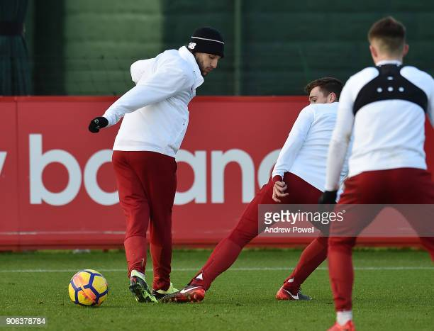 Adam Lallana and Andrew Robertson of Liverpool during a training session at Melwood Training Ground on January 18 2018 in Liverpool England