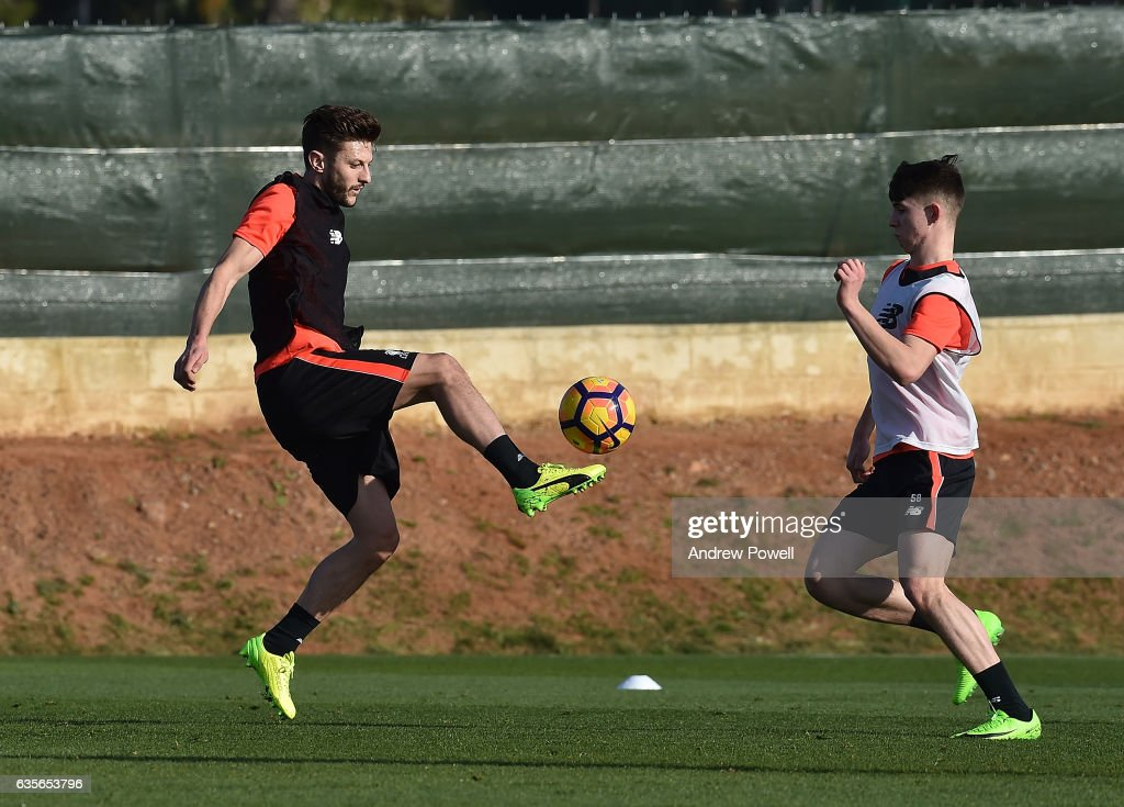Adam Lallana and Ben Woodburn of Liverpool during a training session at La Manga on February 16, 2017 in La Manga, Spain.