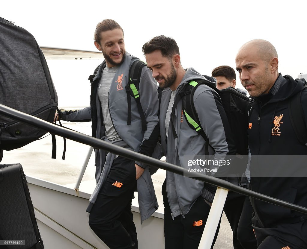 Adam Lallana and Danny Ings of Liverpool board the plane for their trip to Porto at Liverpool John Lennon Airport on February 13, 2018 in Liverpool, England.