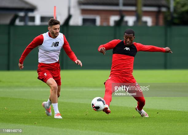 Adam Lallana and Georginio Wijnaldum of Liverpool during a training session at Melwood Training Ground on August 20 2019 in Liverpool England