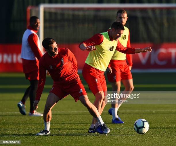 Adam Lallana and James Milner of Liverpool during a training session at Melwood Training Ground on October 18 2018 in Liverpool England