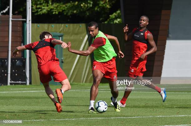 Adam Lallana and Joel Matip of Liverpool during a training session at Melwood Training Ground on August 21 2018 in Liverpool England