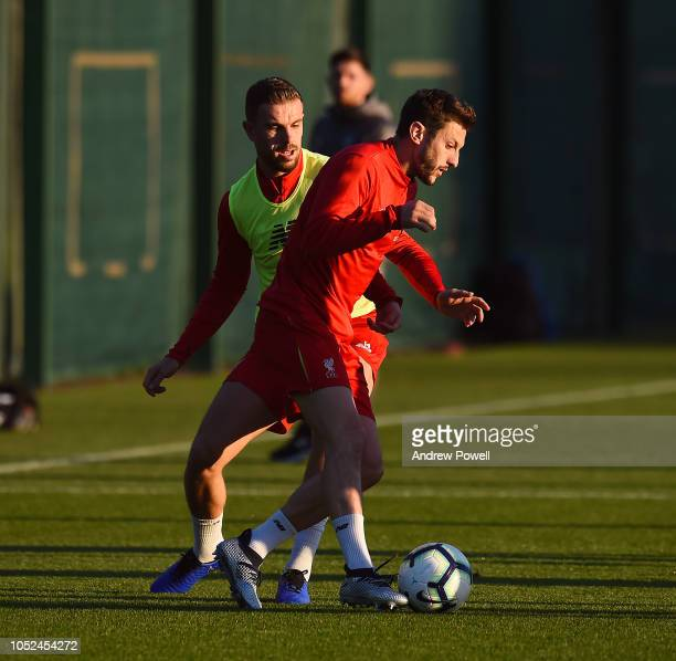 Adam Lallana and Jordan Henderson of Liverpool during a training session at Melwood Training Ground on October 18 2018 in Liverpool England