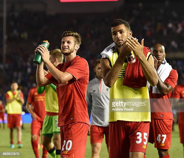 Adam Lallana and Kevin Stewart of Liverpool shows his appreciation to the fans at the end of the International Champions Cup match between Chelsea...