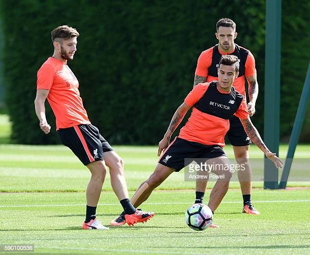 Adam Lallana and Philippe Coutinho of Liverpool during a training session at Melwood Training Ground on August 16 2016 in Liverpool England