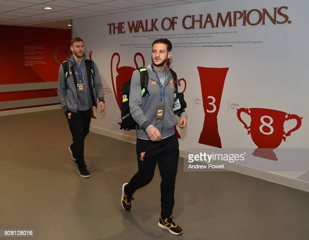 Adam Lallana and Ragnar Klavan of Liverpool arrives before the UEFA Champions League Round of 16 Second Leg match between Liverpool and FC Porto at...