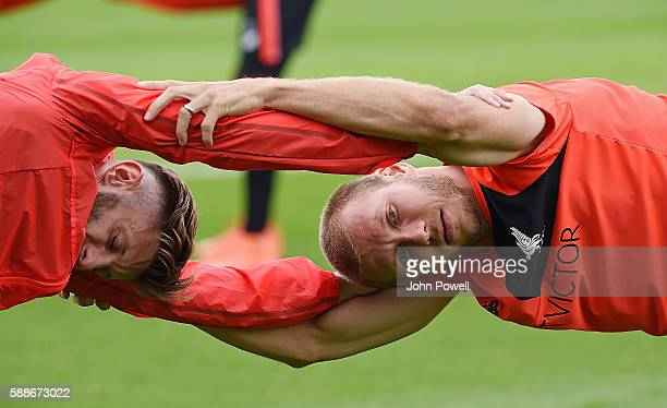 Adam Lallana and Ragnar Klavan of Liverpool during a training session at Melwood Training Ground on August 12 2016 in Liverpool England