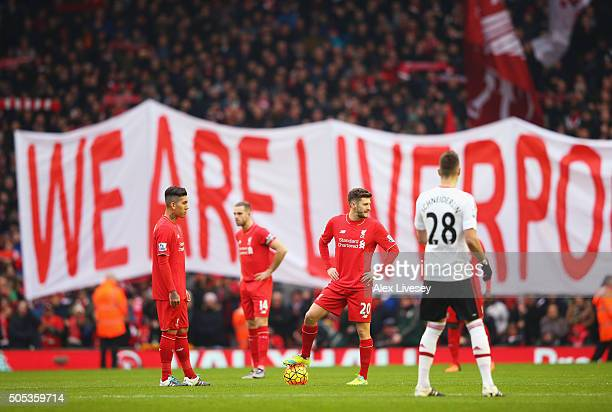 Adam Lallana and Roberto Firmino of Liverpool prepare to kick off during the Barclays Premier League match between Liverpool and Manchester United at...