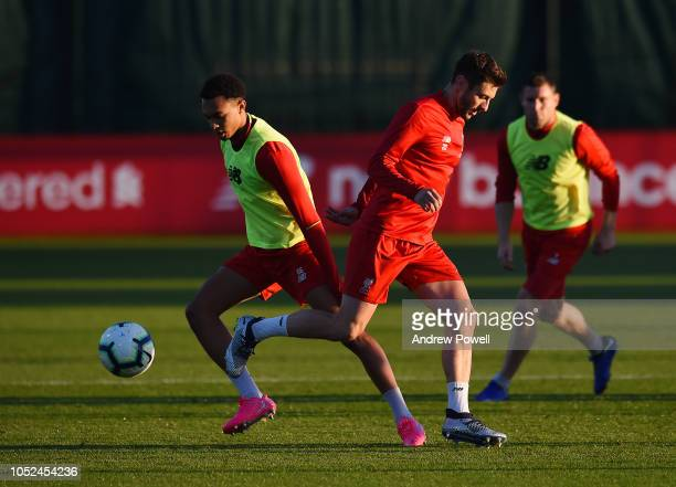 Adam Lallana and Trent AlexanderArnold of Liverpool during a training session at Melwood Training Ground on October 18 2018 in Liverpool England