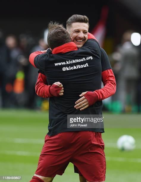 Adam Lallana and Xherdan Shaqiri of Liverpool before the PremierLeague match between Liverpool FC and Tottenham Hotspur at Anfield on March 31 2019...