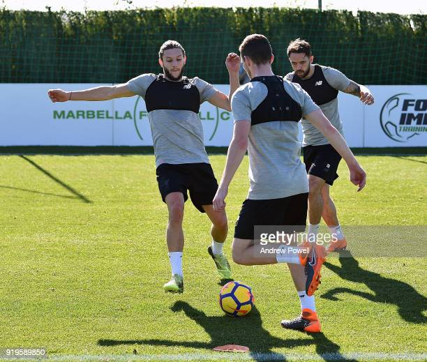 Adam Lallana Danny Ings and Andrew Robertson of Liverpool during a training session at Marbella Football Center on February 17 2018 in Marbella Spain