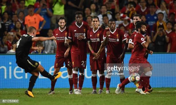 Adam Lallana Divock Origi Roberto Firmino Georginio Wijnaldum Philippe Coutinho and Mohamed Salah of Liverpool defend a free kick during the Premier...