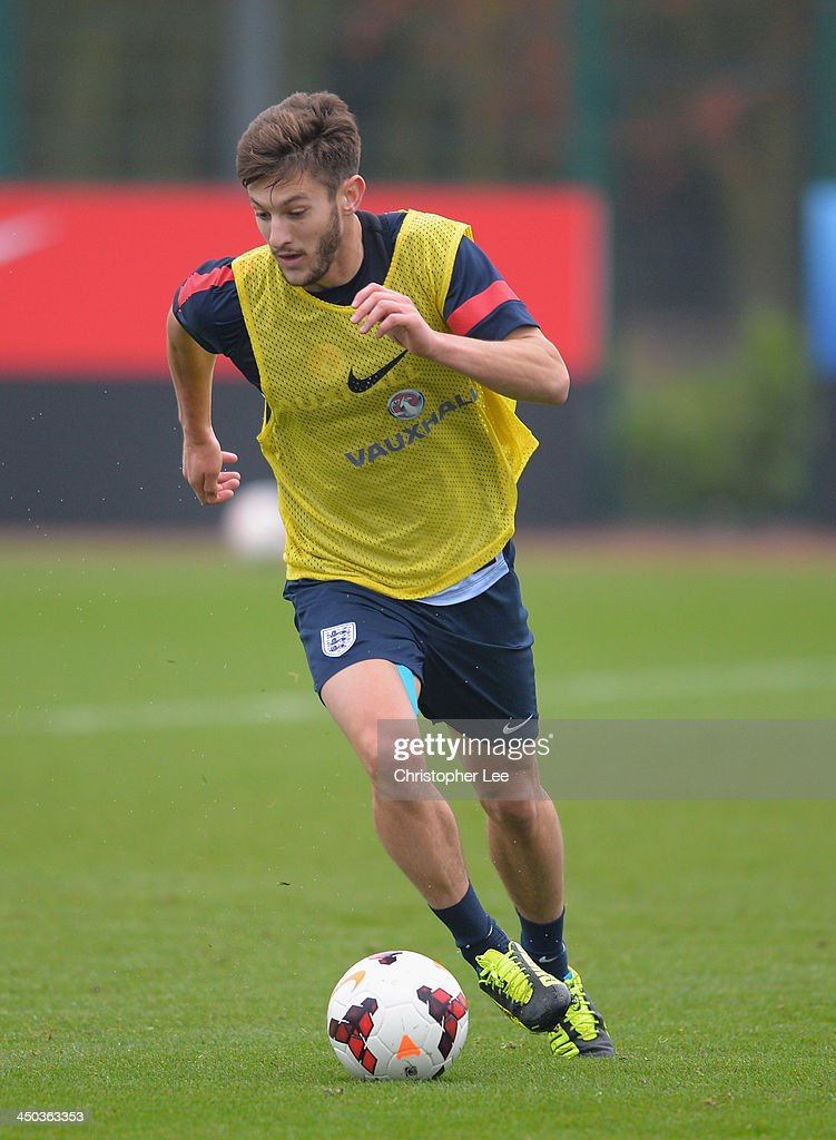 Adam Lallana in action during England Training at London Colney on November 18, 2013 in St Albans, England.