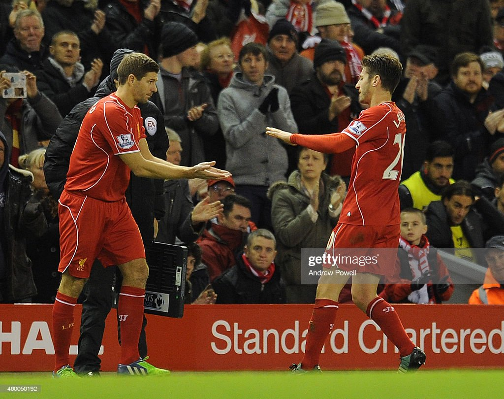 Adam Lallana is replaced by Steven Gerrard of Liverpool during the Barclays Premier League match between Liverpool and Sunderland at Anfield on December 6, 2014 in Liverpool, England.