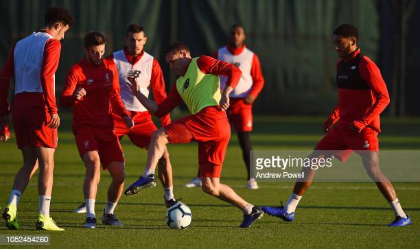 Adam Lallana James MIiner and Joe Gomez of Liverpool during a training session at Melwood Training Ground on October 18 2018 in Liverpool England