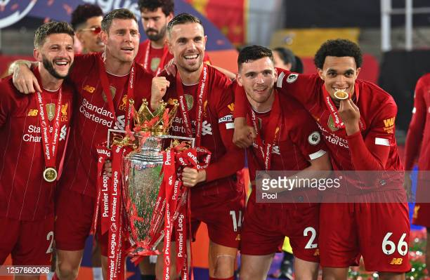 Adam Lallana, James Milner, Jordan Henderson, Andy Robertson and Trent Alexander-Arnold of Liverpool celebrate with The Premier League trophy...