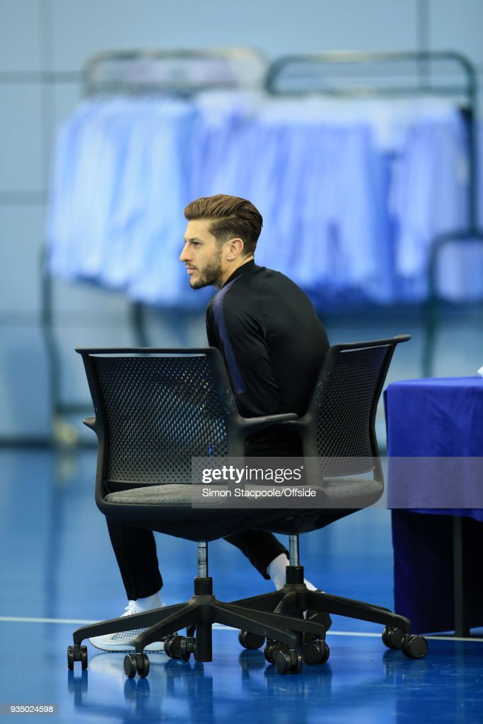 Adam Lallana looks on during an England training session at St. George's Park on March 20, 2018 in Burton-upon-Trent, England.
