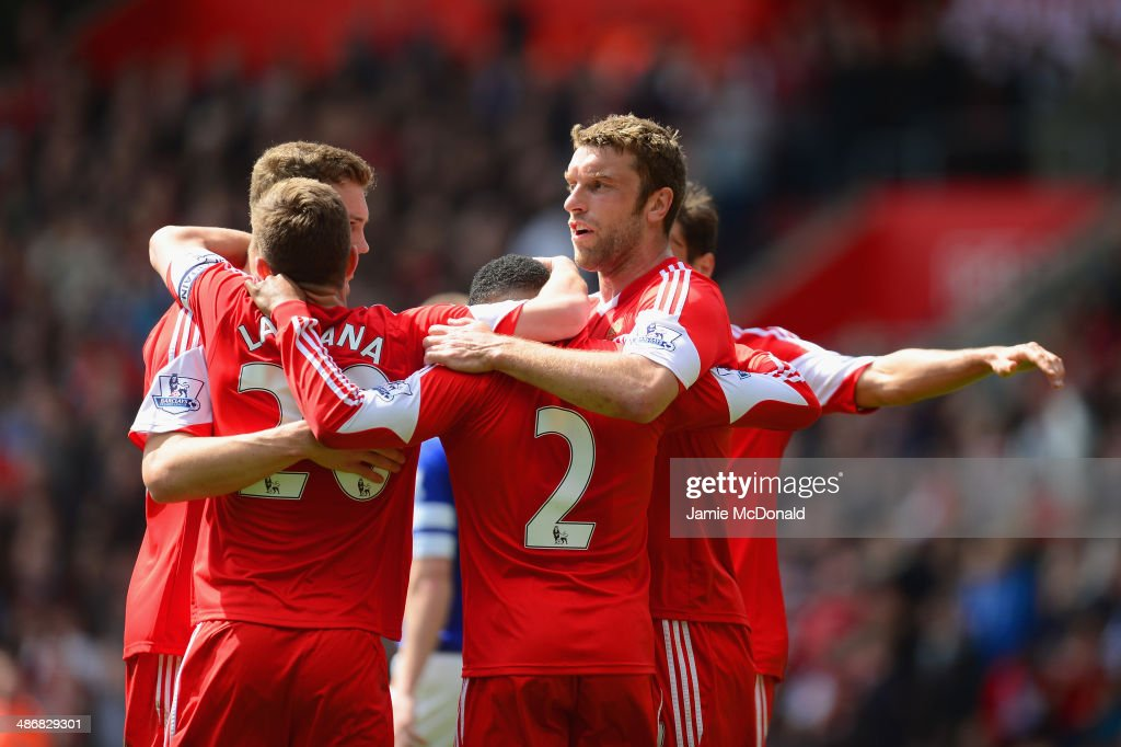 Adam Lallana, Nathaniel Clyne and Rickie Lambert of Southampton celebrate with team mates after Seamus Coleman of Everton scored an own goal to make it 2-0 during the Barclays Premier League match between Southampton and Everton at St Mary's Stadium on April 26, 2014 in Southampton, England.