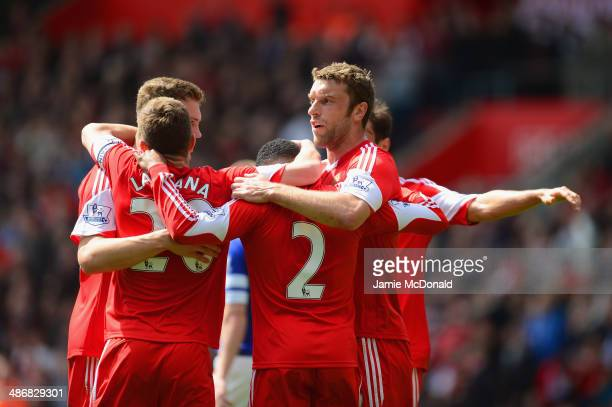 Adam Lallana Nathaniel Clyne and Rickie Lambert of Southampton celebrate with team mates after Seamus Coleman of Everton scored an own goal to make...