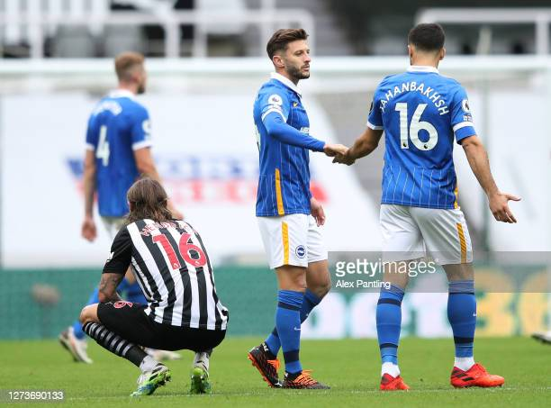 Adam Lallana of Brighton and Hove Albion and Alireza Jahanbakhsh of Brighton and Hove Albion celebrate following their team's victory in the Premier...