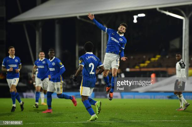 Adam Lallana of Brighton and Hove Albion celebrates after scoring but the goal is disallowed after a VAR review during the Premier League match...