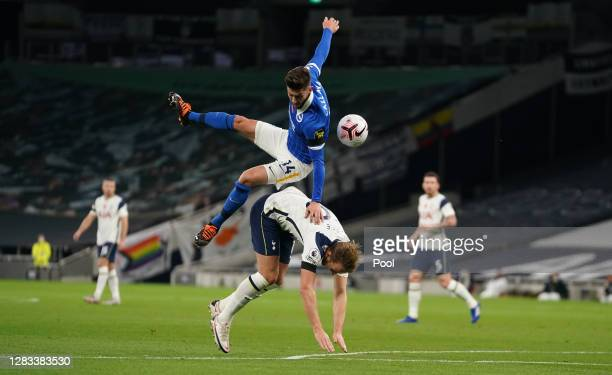 Adam Lallana of Brighton and Hove Albion fouls Harry Kane of Tottenham Hotspur resulting in a penalty during the Premier League match between...