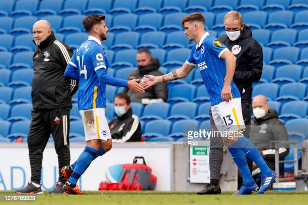 Adam Lallana of Brighton and Hove Albion greets Pascal Gross of Brighton and Hove Albion as Adam Lallana is substituted off and Pascal Gross is...