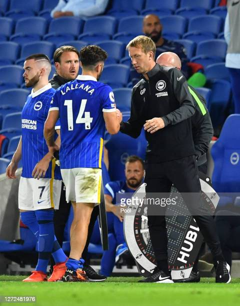 Adam Lallana of Brighton and Hove Albion leaves the pitch with an injury during the Premier League match between Brighton Hove Albion and Chelsea at...