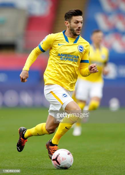 Adam Lallana of Brighton and Hove Albion runs with the ball during the Premier League match between Crystal Palace and Brighton Hove Albion at...