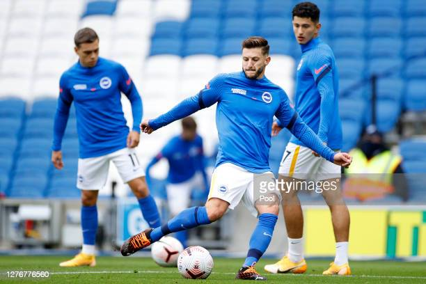 Adam Lallana of Brighton and Hove Albion shoots as he warms up prior to the Premier League match between Brighton Hove Albion and Manchester United...