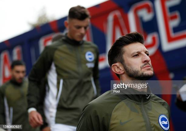 Adam Lallana of Brighton and Hove Albion walks out prior to the Premier League match between Crystal Palace and Brighton Hove Albion at Selhurst Park...