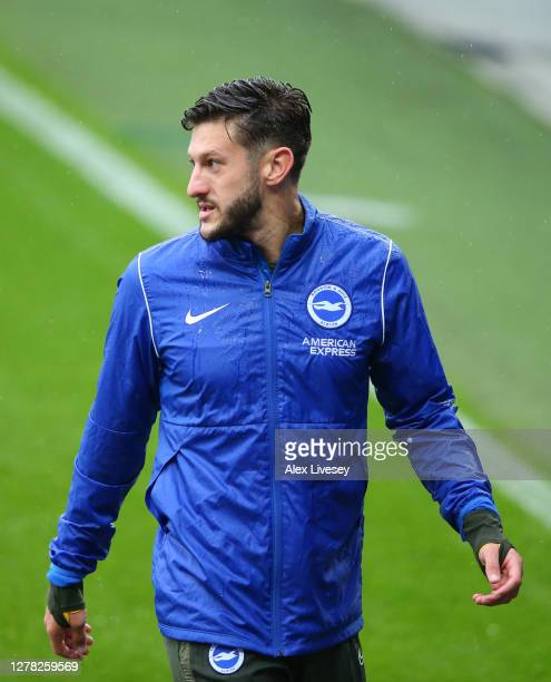Adam Lallana of Brighton and Hove Albion warms up prior to the Premier League match between Everton and Brighton Hove Albion at Goodison Park on...