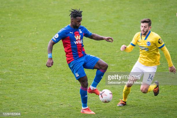 Adam Lallana of Brighton Hove Albion and Jeffrey Schlupp of Crystal Palace in action during the Premier League match between Crystal Palace and...