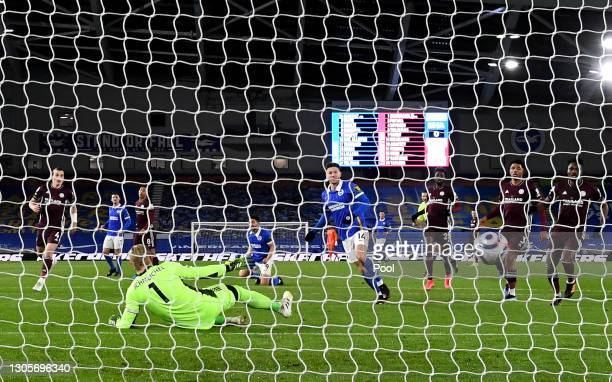 Adam Lallana of Brighton & Hove Albion scores their team's first goal past Kasper Schmeichel of Leicester City during the Premier League match...